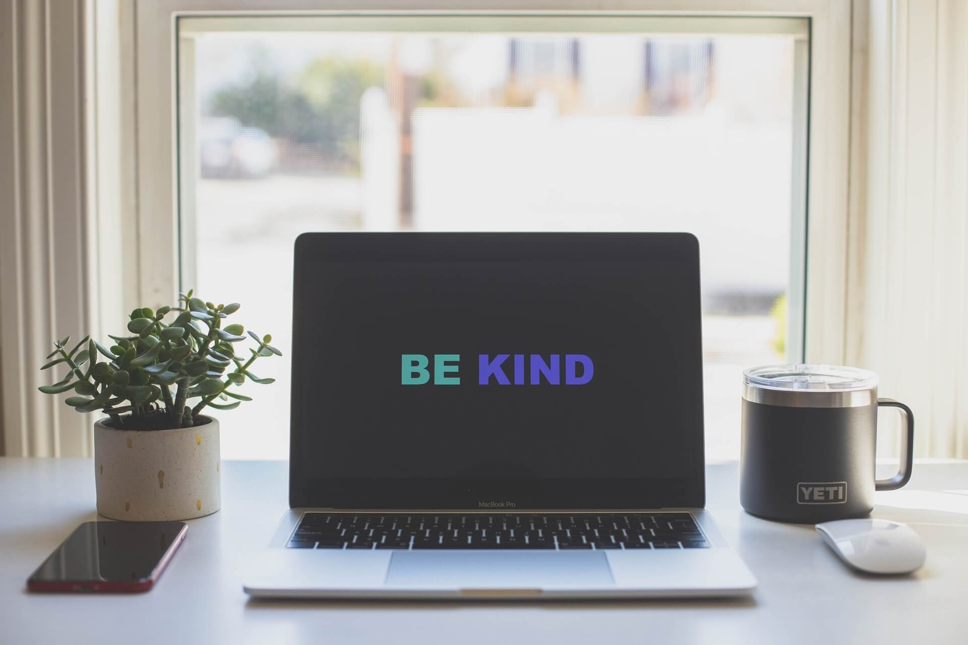 Image of a laptop with the words 'Be Kind' written on