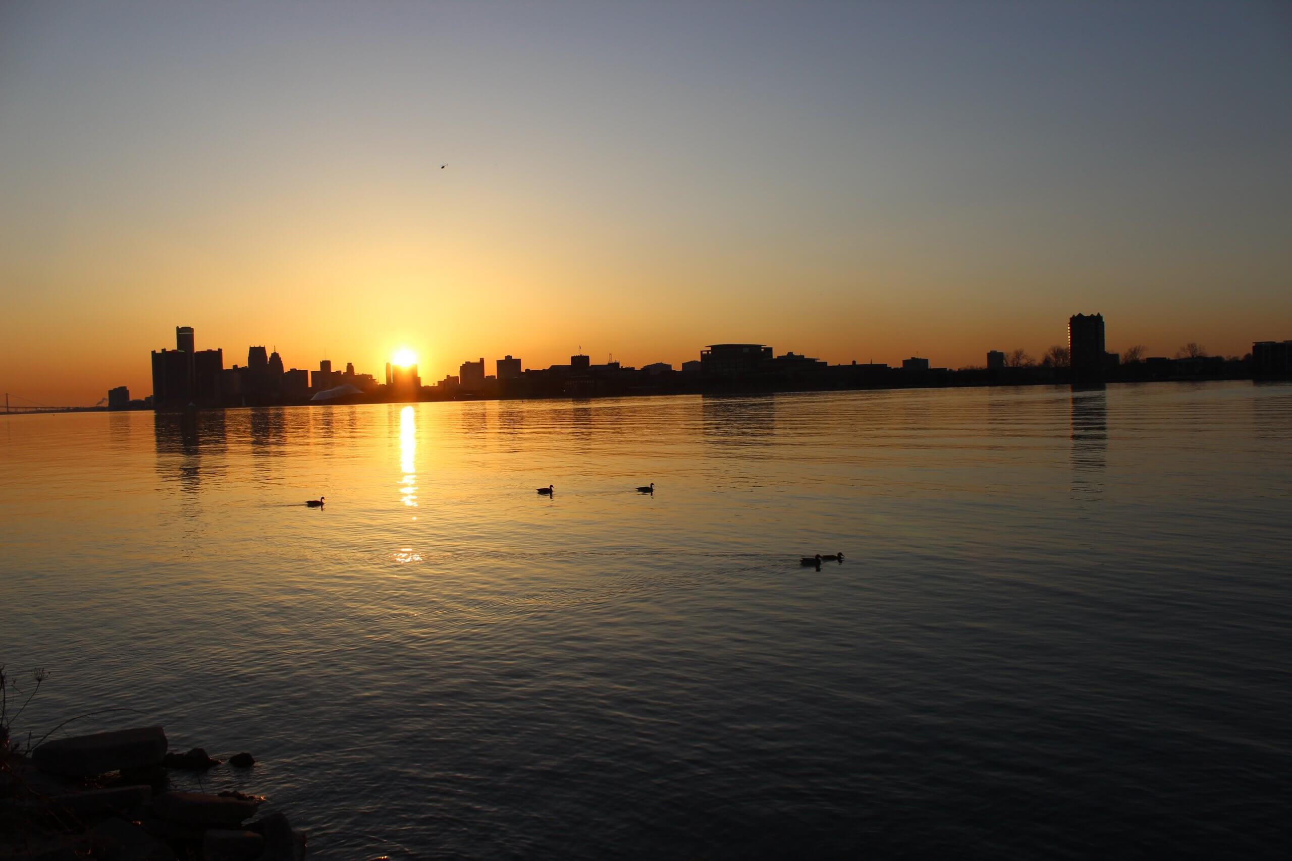 Detroit skyline taken from across the water at sunset